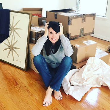 unpacked boxes & paige.JPG