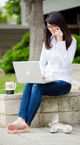 laptop, phone, white shirt jeans, coachi