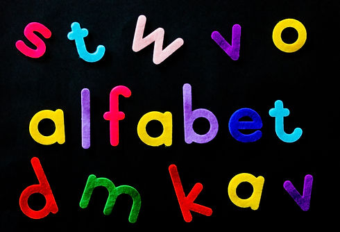 assorted-color-alfabet-letters-on-black-
