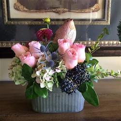 Floral Arrangement Inside Gift Basket by Rhonda Rose Floral