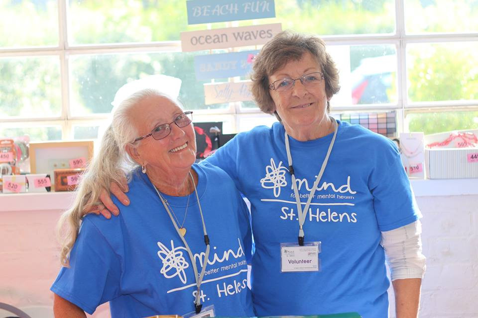 Joan and Maureen take time from the Ladies Craft Group to help at a Family Fun Day
