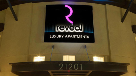 Reveal Apartments Storefront Signage