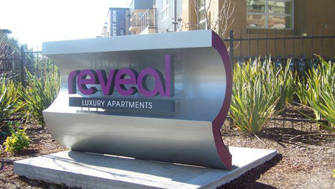 Reveal Apartments Monument Signage