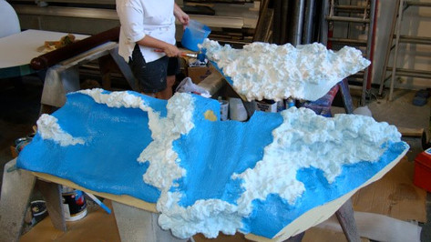 This was an interesting project that involved sculpting waves out of urethane foam, the sand areas were sculpted out of plaster, the upper sky portion takes on a different look at night, during the day it is a bright blue sky with the sun shinning, at night the sun transforms into a moon as the fiberoptic stars twinkle.