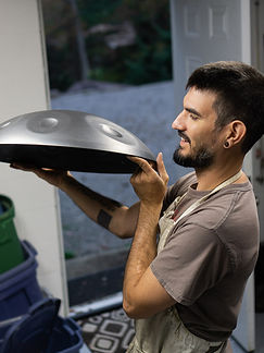 inspecting a handpan before putting into the kiln for handpan heating and cooling process