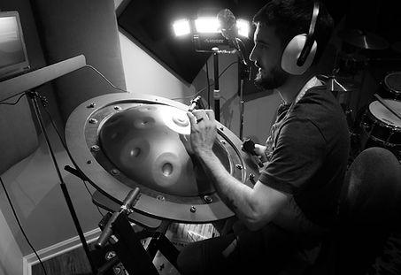 handpan tuner tuning a handpan in handpan tuning rings black and white.jpg