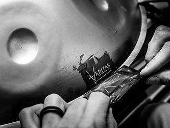 electrolytic handpan etching reveal veritas logo.jpg