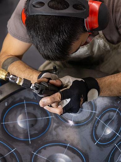air hammering handpan borders into deep drawn ayasa shell.jpg