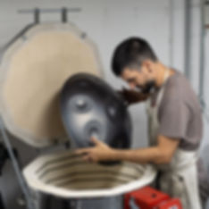 Putting a handpan into Kiln for heating and cooling process.jpg