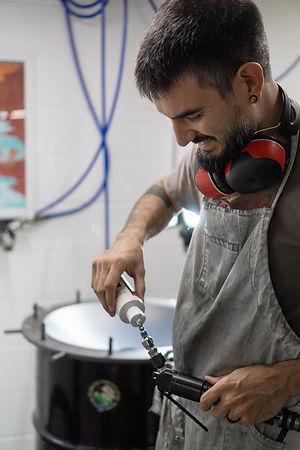 oiling Air Hammer for handpan building.jpg
