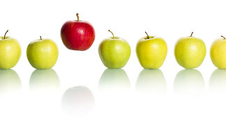 Single red apple floating above a row of
