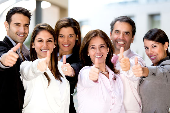 Successful business people with thumbs u