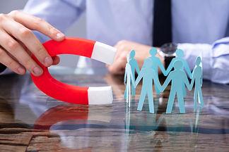 Businessperson Attracting Human Figures