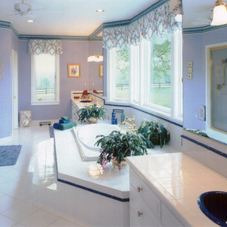Main Floor Master Ensuite with Heated Floors, Steam Room and Jetted Tub