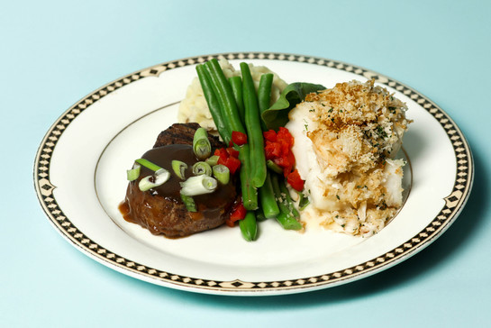 Petite Filet Mignon paired with Ritz Cracker and Lump Crab Crusted Cod Loin