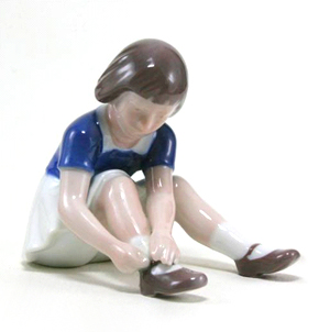 B&G 2317 Girl Sitting On A Floor With a Shoe
