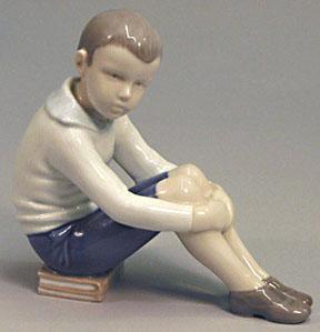 B&G 1742 Boy Sitting on his Books