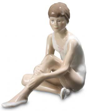 RC 1249331 Ballerina Hands On Her Knee