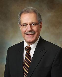 Dr. Charles E. Manner