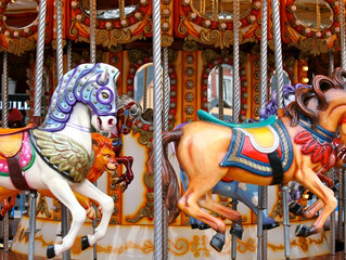 On Merry-Go-Rounds, Motives and Maddening Manipulations