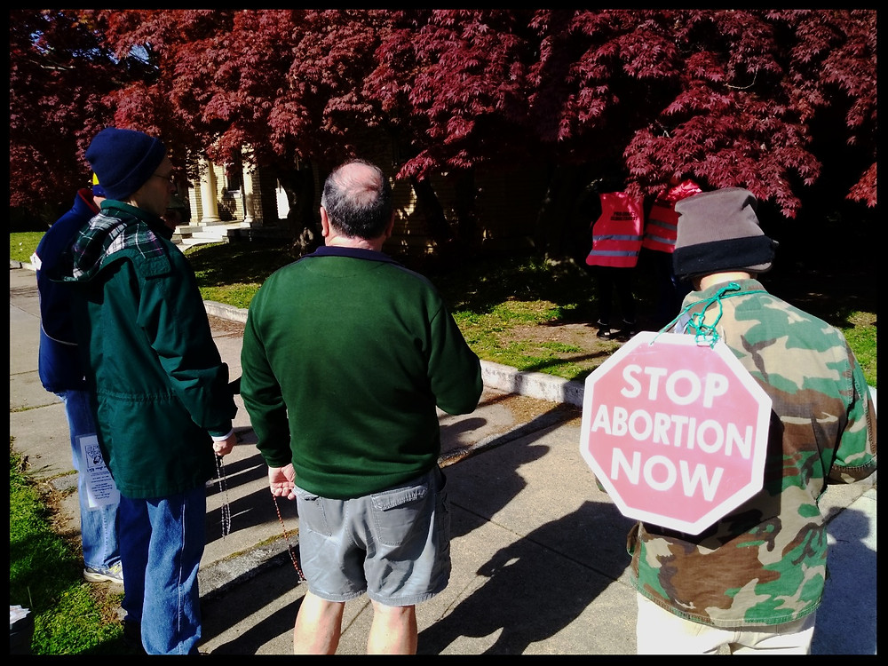 "Some of the Catholic men who prayed the Rosary while the ""Pro-Choice Escorts"" listened."