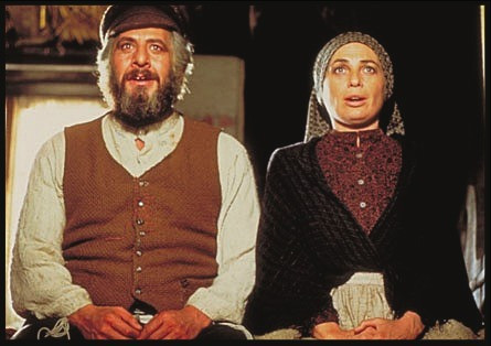 Tevye and Golda sing as portrayed in the movie version of Fiddler on the Roof. Tellingly they sit side by side as partners or friends are often portrayed, not face to face as romantic couples are often portrayed.