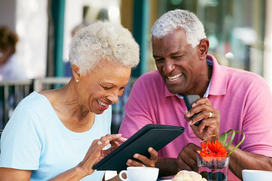 bigstock-Senior-Couple-Using-Tablet-Com-