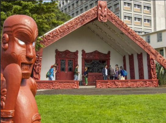 The carvings symbolize the captains who guided the canoes Maori people to New Zealand in the 14th century. The building is also used for Maori Studies classes and seminars.