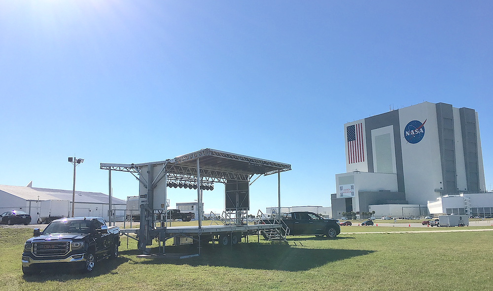 The aXisPro Stageline SL100 w/ Additional Decking and Lighting in the shadows of the VAB.