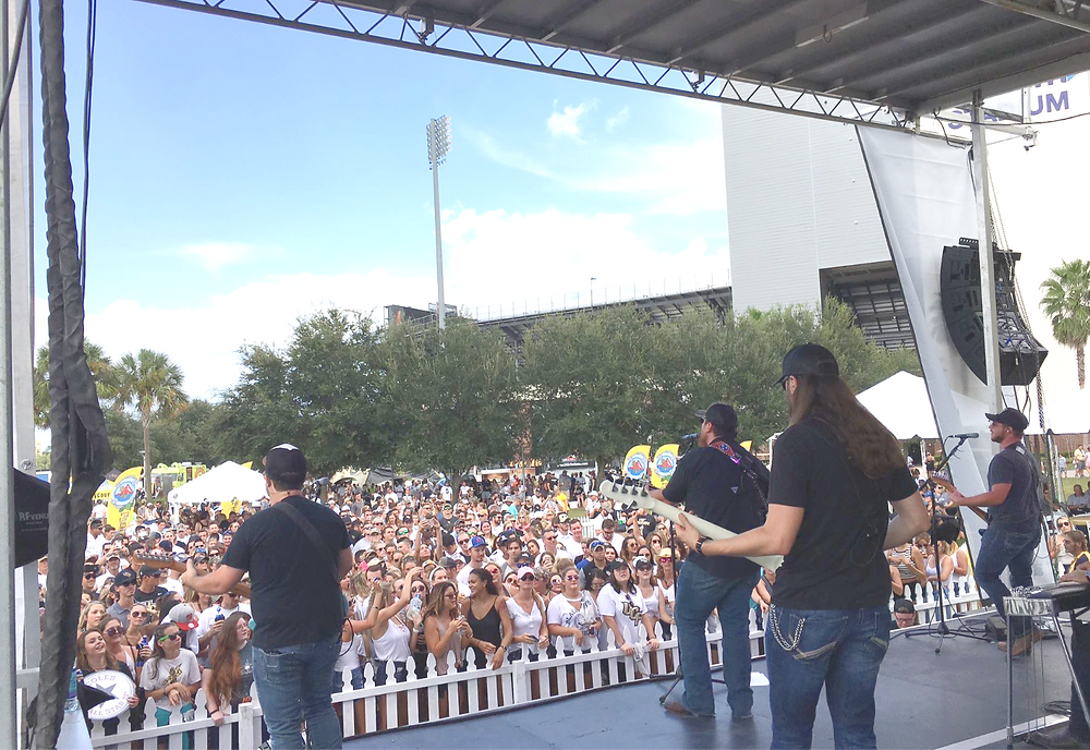 Luke Combs rocking axis Pro Stage at UCF Football Concert Series.