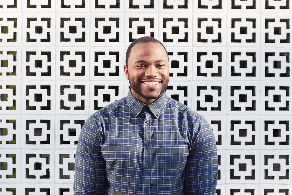 Torion Johnson in front of patterned wall
