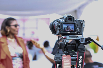 Woman being interviewed on camera