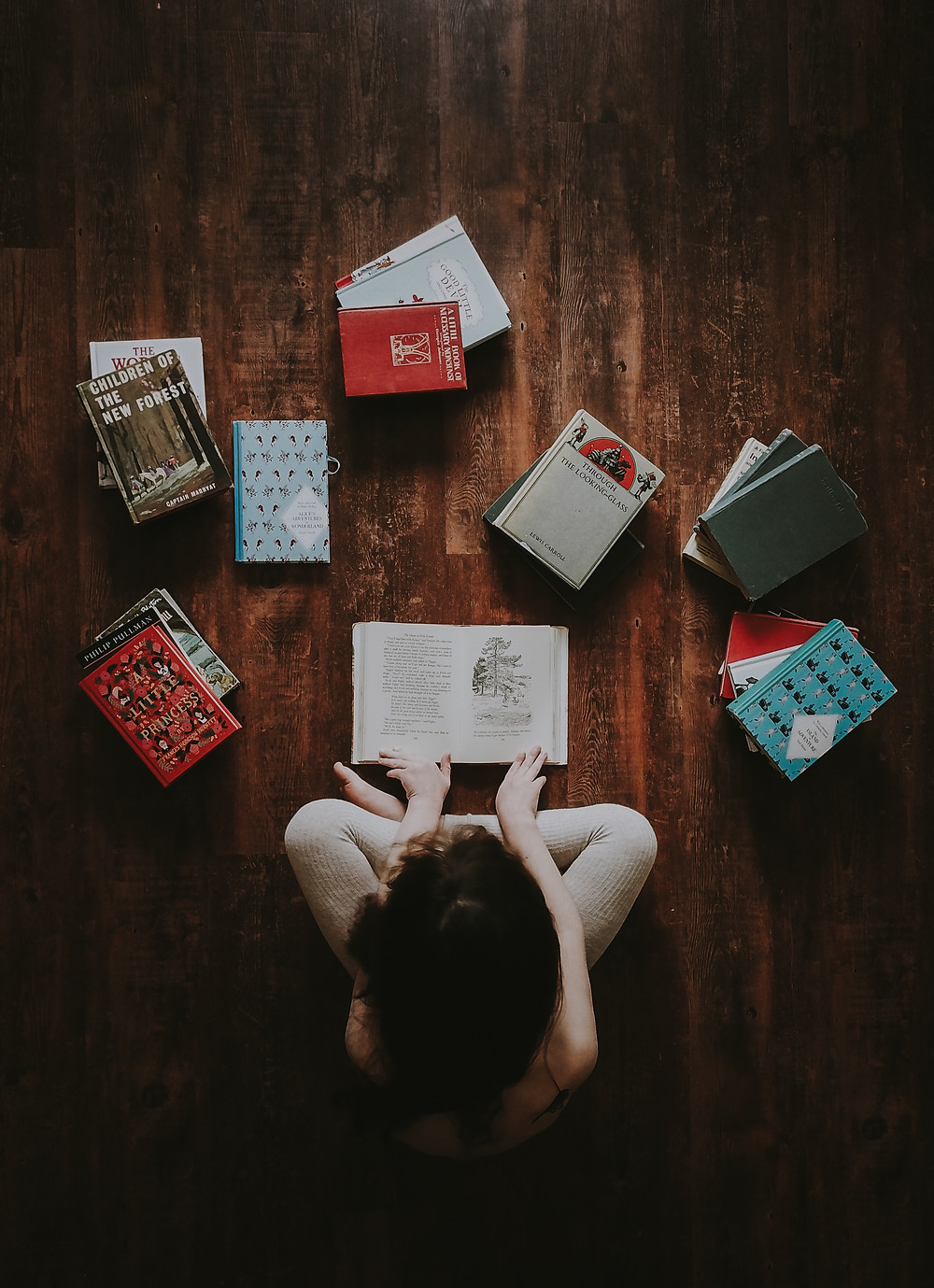 Woman sitting with books