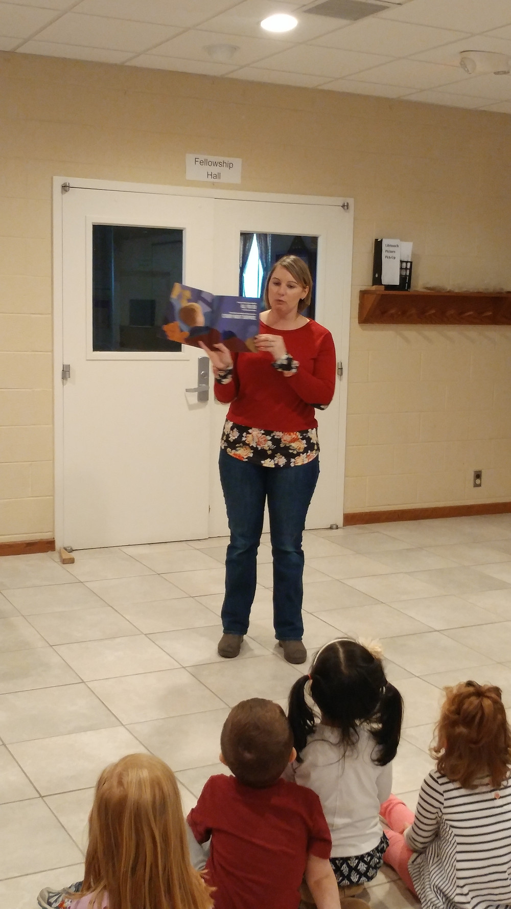 Children's author Lindsay C. Barry reading her book to children