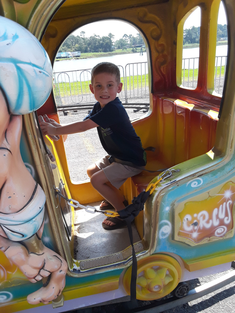 Austin Blackstone Checking Out the Carnival Rides (Photo by Stephanie Wilson)
