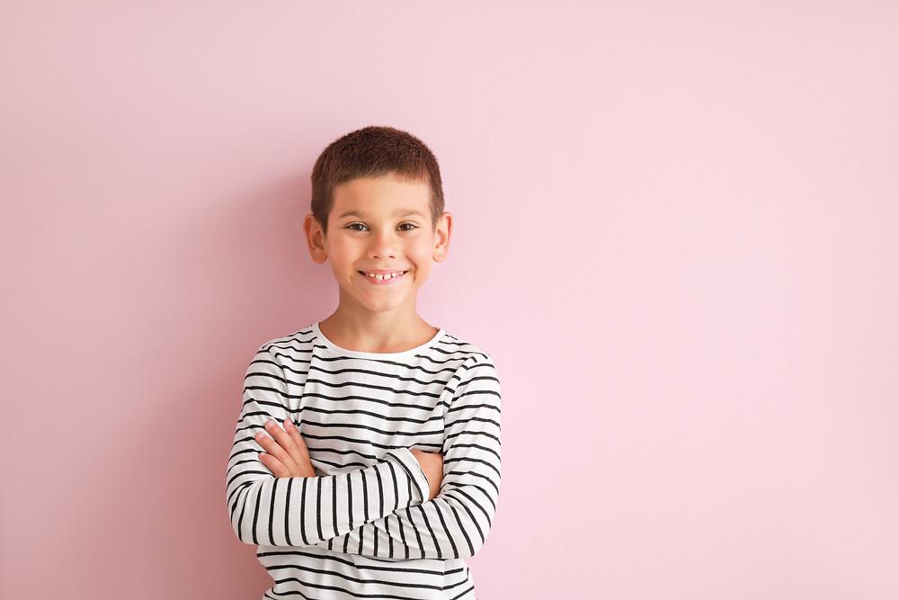 Boy on pink background