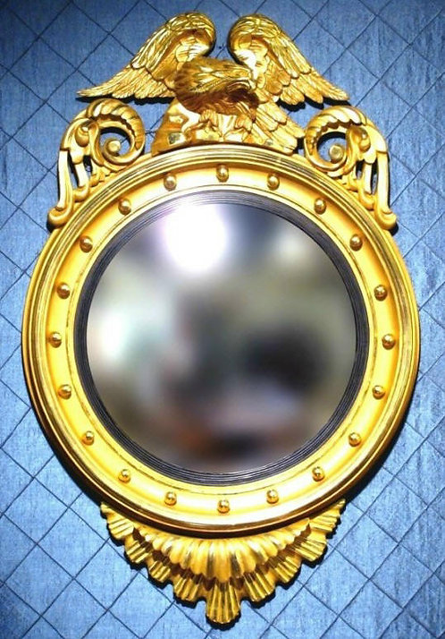 A Very Fine Classical Period Giltwood Bull's Eye or Butlers Mirror