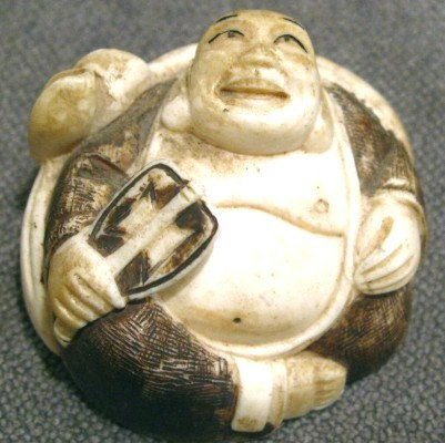 An Early 20th Century Bone Netsuke of a Laughing-Buddha. Japanese, Meiji Period