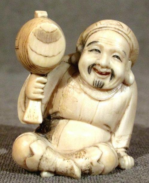 A Carved Japanese Ivory Okimono of Daikoku, Meiji Period (1868-1912)