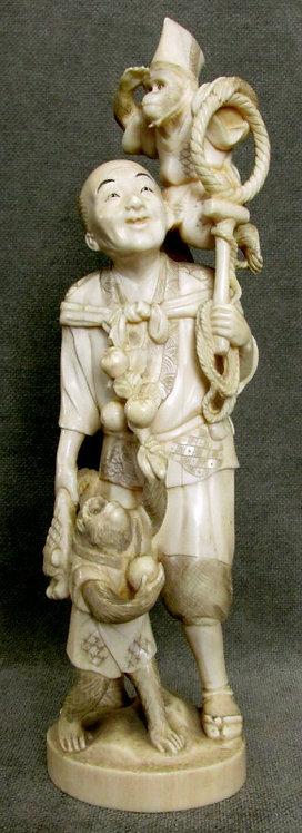 Fine Japanese Ivory Okimono of a Monkey Trainer, Meiji Period (1868-1912)