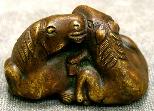 A Chinese Bronze Paperweight in the Form of Two Recumbent Horses