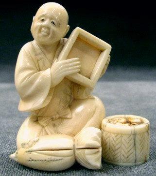 An Amusing Japanese Ivory Okimono, Meiji Period (1868-1912)