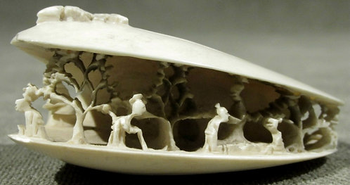 A Finely Carved Ivory Okimono of a Mussel, Meiji Period (1868-1912)