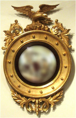 A Fine Regency Period Giltwood Convex Butlers Mirror