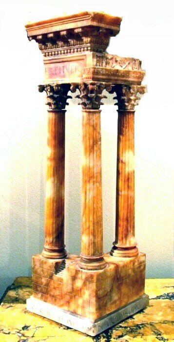 A finely sculpted architectural model of the Temple of Vespasian