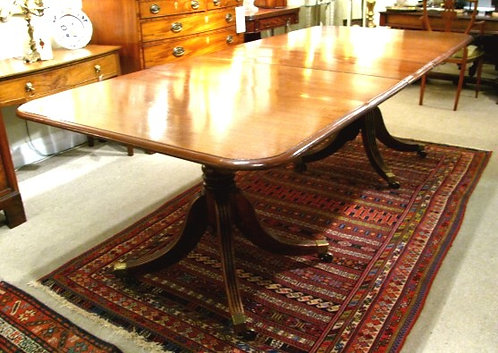 A 19th Century Double Pedestal Dining Table in Figured Mahogany. English