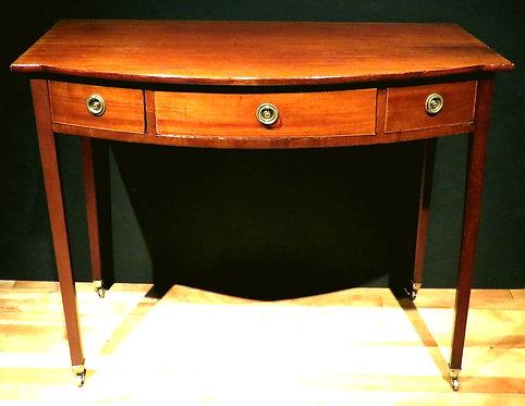 A George III Mahogany Bow Fronted Writing Table, English Circa 1810