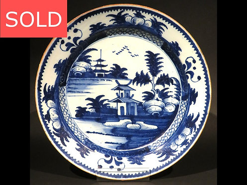 An 18th Century Chinoiserie Decorated English Delft Blue & White Charger, London