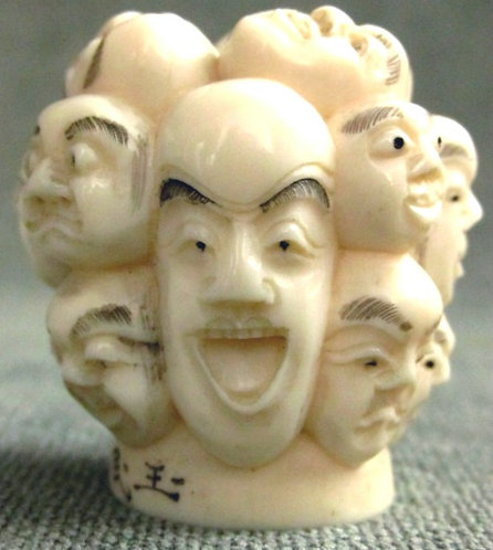 A Signed & Finely Carved 'Thousand Faces' Ivory Cane Handle, Meiji Period