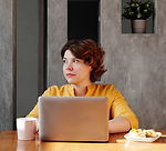 photo-of-woman-sitting-by-the-table-whil
